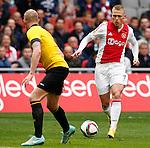 Nederland, Amsterdam, 19 april 2015<br /> Eredivisie<br /> Seizoen 2014-2015<br /> Ajax-NAC Breda (0-0)<br /> Viktor Fischer van Ajax en Henrico Drost van NAC Breda strijden om de bal