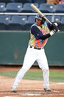 Everett Aquasox outfielder Mario Yepez #24 bats against the Tri-City Dust Devils at Everett Memorial Stadium on August 13, 2011 in Everett,Washington. Everett defeated Tri-City 6-4.(Larry Goren/Four Seam Images)