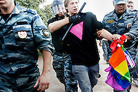 LGBT activist Daniil Grachev is arrested after he was involved in scuffles with anti-gay protestors during a Gay Pride Rally on 29 June 2013. About 250 ultra-nationalists gathered to shout abuse at people taking part in the rally and later some of these protestors violently assaulted some of the participants. On 30 June 2013, Russian President Vladimir Putin signed into law an ambiguous bill banning the 'propaganda of nontraditional sexual relations to minors'. The law met with widespread condemnation from human rights and LGBT groups. The law has since been used to ban Gay Pride Rallies in the city. (MANDATORY CREDIT   photo: Mads Nissen/Panos Pictures /Felix Features)