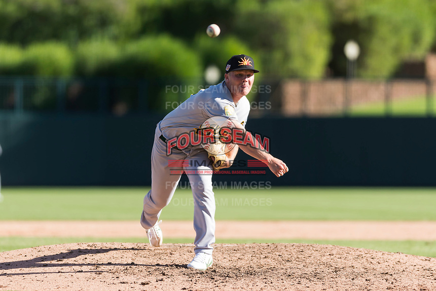 Mesa Solar Sox relief pitcher Jake Bray (15), of the Oakland Athletics organization, delivers a pitch during an Arizona Fall League game against the Glendale Desert Dogs at Camelback Ranch on October 15, 2018 in Glendale, Arizona. Mesa defeated Glendale 8-0. (Zachary Lucy/Four Seam Images)