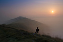 15/09/16 <br /> <br /> A walker stops with his dog on Mam Tor to admire the stunning dawn scene over the Great Ridge as the sun begins to burn through the mist clinging to valley above Castleton in the Derbyshire Peak District on what is forecast to be the third day in a row where UK temperatures will top 30 degrees. <br /> All Rights Reserved: F Stop Press Ltd. +44(0)1773 550665   www.fstoppress.com