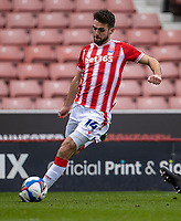 20th March 2021; Bet365 Stadium, Stoke, Staffordshire, England; English Football League Championship Football, Stoke City versus Derby County; Tommy Smith of Stoke City crosses the ball