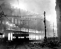 A burning building in Sheffield which was raided recently.  December 1941.  New Times Paris Bureau Collection.  (USIA)<br /> Exact Date Shot Unknown<br /> NARA FILE #:  306-NT-901C-7<br /> WAR & CONFLICT BOOK #:  1005