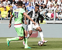 Calcio, Serie A: Juventus vs Crotone. Torino, Juventus Stadium, 21 maggio 2017.<br /> Juventus' Alex Sandro, right, challenged by Crotone's Mario Sampirisi during the Italian Serie A football match between Juventus and Crotone at Turin's Juventus Stadium, 21 May 2017. Juventus defeated Crotone 3-0 to win the sixth consecutive Scudetto.<br /> UPDATE IMAGES PRESS/Isabella Bonotto