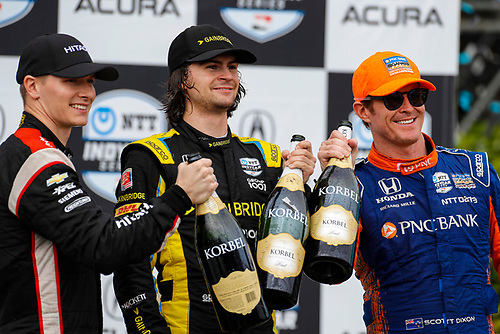 #26: Colton Herta, Andretti Autosport w/ Curb-Agajanian Honda, #2: Josef Newgarden, Team Penske Chevrolet, #9: Scott Dixon, Chip Ganassi Racing Honda celebrate with champagne on the podium