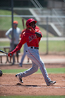 Los Angeles Angels second baseman Daniel Ozoria (23) follows through on his swing during an Extended Spring Training game against the Giants Black at the San Francisco Giants Training Complex on May 25, 2018 in Scottsdale, Arizona. (Zachary Lucy/Four Seam Images)