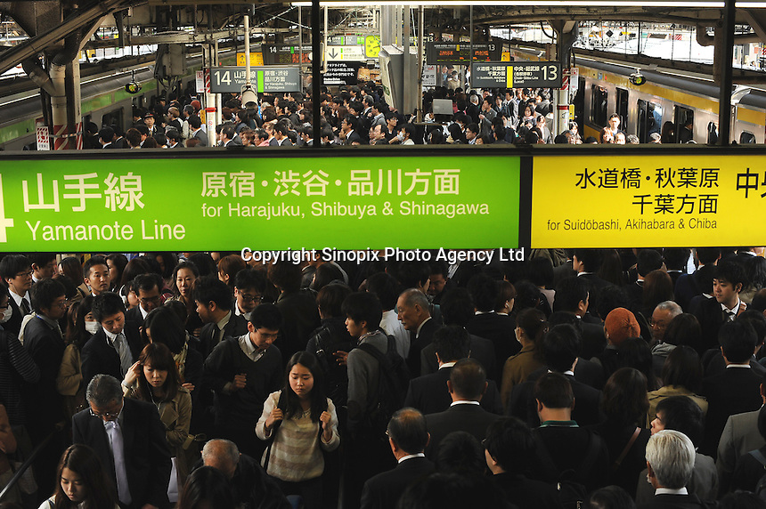 A packed platform during morning rush hour, Shinjuku, Tokyo. With up to 4 million passengers passing through it every day, Shinjuku station, Tokyo, Japan, is the busiest train station in the world. The station was used by an average of 3.64 million people per day.  That's 1.3 billion a year.  Or a fifth of humanity. Shinjuku has 36 platforms, and connects 12 different subway and railway lines.  Morning rush hour is pandemonium with all trains 200% full. <br /> <br /> Photo by Richard jones / sinopix
