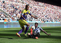 Pictured L-R: Wayne Routledge of Swansea against Mathieu Debuchy of Newcastle. Saturday 19 April 2014<br /> Re: Barclay's Premier League, Newcastle United v Swansea City FC at St James Park, Newcastle, UK.