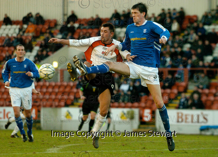14/01/2006         Copyright Pic: James Stewart.File Name : sct_jspa14_clyde_v_stjohnstone.KEVIN JAMES CLEARS FROM ALEX WILLIAMS....Payments to :.James Stewart Photo Agency 19 Carronlea Drive, Falkirk. FK2 8DN      Vat Reg No. 607 6932 25.Office     : +44 (0)1324 570906     .Mobile   : +44 (0)7721 416997.Fax         : +44 (0)1324 570906.E-mail  :  jim@jspa.co.uk.If you require further information then contact Jim Stewart on any of the numbers above.........