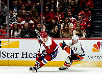 WASHINGTON, DC - JANUARY 31: Dmitry Orlov #9 of the Washington Capitals  moves way from Casey Cizikas #53 of the New York Islanders during a game between New York Islanders and Washington Capitals at Capital One Arena on January 31, 2020 in Washington, DC.