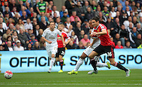 Pictured L-R: Wayne Routledge of Swansea against Matteo Darmian of Manchester United Sunday 30 August 2015<br /> Re: Premier League, Swansea v Manchester United at the Liberty Stadium, Swansea, UK