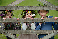 BNPS.co.uk (01202 558833)<br /> Pic: ZacharyCulpin/BNPS <br /> <br /> Weather input - <br /> <br /> Crowning glories: Dorset Flower Farmers, the Priestley family perfect their flower crown-making ahead of Garden Day on Sunday 9th May, the nationwide celebration of the benefits of gardens for health and wellbeing.  <br /> <br /> Pictured: Siblings, Isadora Priestley, 7, Milo, 9, and Arabella, 5, show off their flower crowns in the garden<br /> <br /> Garden Day will be back for a third successive year on Sunday, 9th May 2021 to celebrate outdoor and indoor garden spaces. The nationwide  movement is calling on plant-lovers to make a flower crown, and share their plant spaces with family and<br /> friends