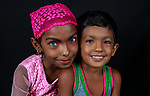 Pictured: Tasnim and Mehedi <br /> <br /> Family members with an unusual pigmentation show off their shockingly bright, blue eyes.  Eyes of this colour are rare for people of a darker skin tone, and the cause is a lack of melanin pigment in the iris of the eye.<br /> <br /> Lower levels of melanin are more commonly found in people with lighter skin tones, meaning they are more likely to have lighter coloured eyes.  The grandfather's name is Shukur Mia, who is photographed with his granddaughter Tasnim, 11, and grandson Mehedi, 6.  SEE OUR COPY FOR DETAILS.<br /> <br /> Please byline: Sultan Ahmed Niloy/Solent News<br /> <br /> © Sultan Ahmed Niloy/Solent News & Photo Agency<br /> UK +44 (0) 2380 458800