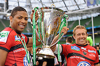 Jonny Wilkinson (right) and Delon Armitage of RC Toulon celebrate with the trophy after winning the Heineken Cup Final between ASM Clermont Auvergne and RC Toulon at the Aviva Stadium, Dublin on Saturday 18th May 2013 (Photo by Rob Munro)