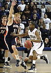 Bucknell's Joe Willman pressures Nevada's Deonte Burton during a second round NIT college basketball game in Reno, Nev., on Sunday, March 18, 2012. Nevada won 75-67..Photo by Cathleen Allison
