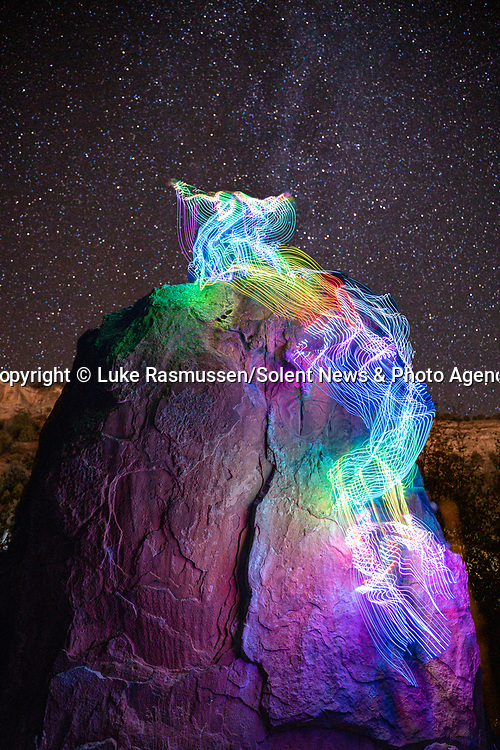 """Pictured:  A 24 seconds exposure at Wolcott, CO<br /> <br /> Bright bolts of colourful light snake their way across mountains and cliffs.  The striking images were created by a rock climber who wrapped LED lights around his body before capturing long exposure shots of his route.<br /> <br /> Luke Rasmussen took the photos in the deserts of Nevada, in the United States, and admits that his method of 'freezing time in a moment' is unusual.  The 28 year old photographer said: """"Wearing a sweater full of lights and climbing through the darkness of night is certainly a different experience than most climbers will get.  SEE OUR COPY FOR DETAILS.<br /> <br /> Please byline: Luke Rasmussen/Solent News<br /> <br /> © Luke Rasmussen/Solent News & Photo Agency<br /> UK +44 (0) 2380 458800"""