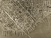 historical aerial photograph of the San Francisco financial district and piers, California, 1946