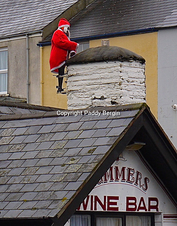 Santa drops in for a quick one.<br /> <br /> Stock Photo by Paddy Bergin