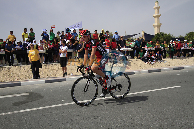 BMC Racing Team rider Danilo Wyss (SUI) passes local school children before the start of the 3rd Stage of the 2012 Tour of Qatar running 146.5km from Dukhan Souq, Dukhan to Al Gharafa, Qatar. 7th February 2012.<br /> (Photo Eoin Clarke/Newsfile)