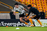 30th October 2020; Molineux Stadium, Wolverhampton, West Midlands, England; English Premier League Football, Wolverhampton Wanderers versus Crystal Palace; Raúl Jiménez and Pedro Neto of Wolverhampton Wanderers warm-up prior to the match