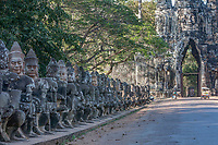 Cambodia, Angkor Thom, South Gate.  The figures lining the road are gods.