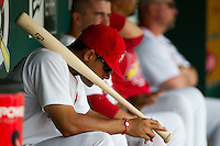 Thomas Pham (4) of the Springfield Cardinals sits in the dugout during a game against the Tulsa Drillers at Hammons Field on June 27, 2011 in Springfield, Missouri. (David Welker / Four Seam Images)