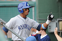 Infielder/second baseman Russell Wilson (3) of the Asheville Tourists, Class A affiliate of the Colorado Rockies, in a game against the Greenville Drive on May 1, 2011, at Fluor Field at the West End in Greenville, S.C. Wilson was a fourth-round pick in the 2010 First-Year Player Draft. Photo by Tom Priddy / Four Seam Images