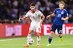 Milad Mohammadikeshmarzi of Iran (L) fights for the ball with Doan Ritsu of Japan (R) during the AFC Asian Cup UAE 2019 Semi Finals match between I.R. Iran (IRN) and Japan (JPN) at Hazza Bin Zayed Stadium  on 28 January 2019 in Al Alin, United Arab Emirates. Photo by Marcio Rodrigo Machado / Power Sport Images