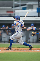Mattingly Romanin (28) of the Bluefield Blue Jays follows through on his swing against the Burlington Royals at Burlington Athletic Park on July 1, 2015 in Burlington, North Carolina.  The Royals defeated the Blue Jays 5-4. (Brian Westerholt/Four Seam Images)