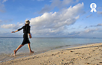 Woman with netbook running on beach (Licence this image exclusively with Getty: http://www.gettyimages.com/detail/87990858 )