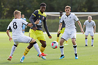 Morgan Clark of Swansea (L) holds back Kazeem Olaigbe of Southampton (C) during the U18 Premier League match between Swansea City and Southampton at Landore Training Ground, Swansea, Wales, UK. Saturday 17 August 2019