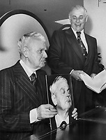 1975 FILE PHOTO -<br /> <br /> Asked to autograph an old photograph of himself for Star photographer Boris Spremo, who took the picture, John Diefenbaker happily imitates the expression, entertaining Robert Jamieson of Simpsons. It happened during an autograph session at the store yesterday publicizing Dief's memoirs.