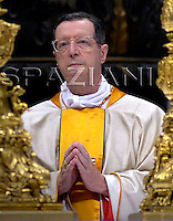 Cardinal Giovanni Lajolo of Italy New cardinal Leonardo Sandri of Argentina A newly elevated cardinal attends a Mass celebrated by Pope Benedict XVI, seen in the background wearing yellow, in which he gave each new cardinal a golden ring, inside St. Peter's Basilica, at the Vatican, Sunday, Nov. 25, 2007