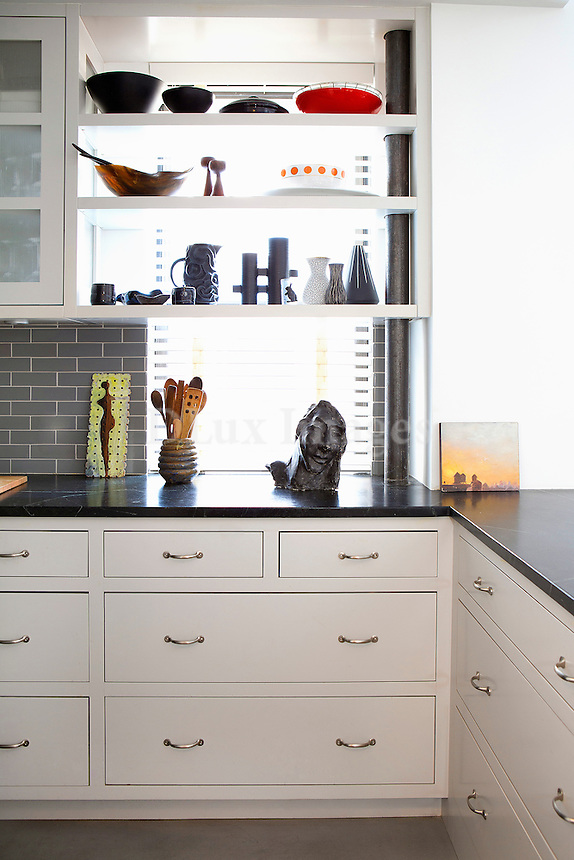 Shelves with bowls and vases