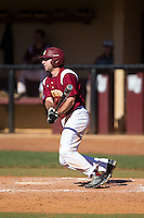 Brad Kaczka (14) of the Winthrop Eagles follows through on his swing against the Kennesaw State Owls at the Winthrop Ballpark on March 15, 2015 in Rock Hill, South Carolina.  The Eagles defeated the Owls 11-4.  (Brian Westerholt/Four Seam Images)
