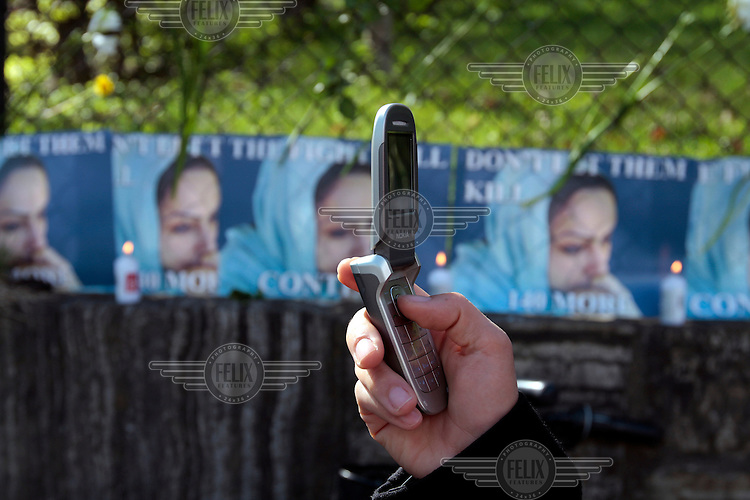 Oslo, Norway: A protester use a mobile phone to photograph. Demonstration against the execution of Iranian woman Delara Darabi who was sentenced to death at the age of 17. Amnesty held a protest in front of the Iranian embassy. .©Fredrik Naumann/Felix Features for Amnesty.