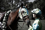 A vintage horse jockey rider and her race horse in the winner circle