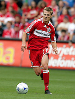 Chicago Fire midfielder Chris Rolfe (17) dribbles the ball.  The Columbus Crew tied the Chicago Fire 2-2 at Toyota Park in Bridgeview, IL on September 20, 2009.