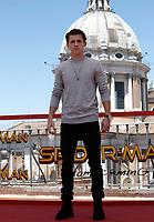 """L'attore britannico Tom Holland posa durante un photocall per la presentazione del film """"Spider-Man: Homecoming"""" a Roma, 20 giugno 2017. <br /> British actor Tom Holland poses during a photocall for the presentation of the movie """"Spider-Man: Homecoming"""" in Rome, June 20, 2017.<br /> UPDATE IMAGES PRESS/Isabella Bonotto"""