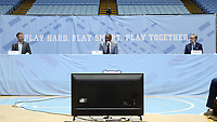 CHAPEL HILL, NC - APRIL 6: UNC men's basketball head coach Hubert Davis is flanked by Chancellor Kevin Guskiewicz and Athletic Director Bubba Cunningham during Davis's introductory press conference at Dean E. Smith Center on April 6, 2021 in Chapel Hill, North Carolina.