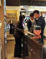 Mainland Chinese shop at a Gucci shop on Canton Road in Hong Kong. Outbound tourists from mainland China spent some $42 billion overseas (including Hong Kong, Macau and Taiwan) last year, outspending inbound international tourists for the first time. Hong Kong, is a leading destination for mainland tourists and is leading centre for luxury fashion brands carry the complete range of one of the world's top fashion brands products..
