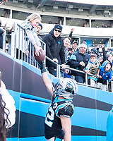 CHARLOTTE, NC - DECEMBER 15: Christian McCaffrey #22 of the Carolina Panthers gives the ball to a young fan after scoring a touchdown during a game between Seattle Seahawks and Carolina Panthers at Bank of America Stadium on December 15, 2019 in Charlotte, North Carolina.