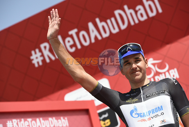 Nikolay Trusov (RUS) Gazprom-Rusvelo wears the Black Intermediate Sprints Points Jersey at sign on before the start of Stage 2 of the 2018 Abu Dhabi Tour, Yas Island Stage running 154km from Yas Mall to Yas Beach, Abu Dhabi, United Arab Emirates. 22nd February 2018.<br /> Picture: LaPresse/Fabio Ferrari | Cyclefile<br /> <br /> <br /> All photos usage must carry mandatory copyright credit (© Cyclefile | LaPresse/Fabio Ferrari)