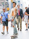 2 SEPTEMBER 2015 NEW YORK CITY <br /> <br /> NON EXCLUSIVE <br /> <br /> Justin Bieber spotted skateboarding outside the Radio City Music Hall while flashing his 'Calvin Klein' underwear in New York City - before heading into The Tonight Show Starring Jimmy Fallon. The singer was wearing a ripped jeans and a pair of Yeezys.