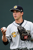 Catcher Luis Torrens (20) of the Charleston RiverDogs warms up before a game against the Greenville Drive on Monday, April 14, 2014, at Fluor Field at the West End in Greenville, South Carolina. Torrens is the No. 19 prospect of the New York Yankees, according to Baseball America. Charleston won, 11-3. (Tom Priddy/Four Seam Images)