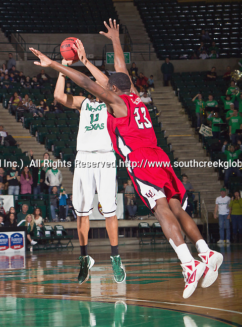 North Texas Mean Green forward Tony Mitchell (13) and Louisiana Lafayette Ragin Cajuns forward/center Kadeem Coleby (23) in action during the game between the Louisiana Lafayette Ragin Cajuns and the University of North Texas Mean Green at the North Texas Coliseum,the Super Pit, in Denton, Texas. Louisiana Lafayette defeats UNT 57 to 53.