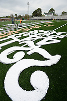 Employees with GeoSurfaces cut out numbers Tuesday, April 27, 2021, that will be used to mark the yardage of a newly installed artificial playing surface at Jonathan Ramey Memorial Field in Greenland. The artificial surface will also feature a large pirate, the school's mascot, at midfield. The project, which also included artificial playing surfaces at the school's baseball and softball fields, is expected to be completed early next week. Visit nwaonline.com/210428Daily/ for today's photo gallery. <br /> (NWA Democrat-Gazette/Andy Shupe)