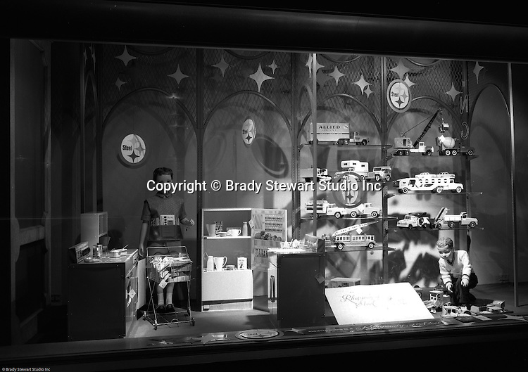 Client: US Steel<br /> Ad Agency: US Steel Marketing<br /> Contact:<br /> Product: Steel displays and fixtures and consumer products made from steel.<br /> Location: Hornes Department Store in downtown Pittsburgh<br /> <br /> View of Christmas window display at Horne's department store in downtown Pittsburgh. Steel toys on display during the Rhapsody of Steel campaign. US Steel launched an awareness campaign of all the current uses of steel in everyday products.  During this time, ALCOA Aluminum Company of America also headquartered in Pittsburgh, was aggressively competing to enter markets where US  steel companies traditionally dominated market share. Examples included beer and food Cans, appliances, automobile parts, children's toys/bicycles, and more.