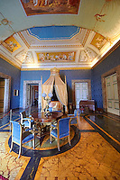 """The Bedroom of Francis II"". The room furnished with a four poster bed, chest of drawers and table in the Empire Style in mahogany & gilt. The vaulted ceiling is freaked with an allegory of the victory of Napoleon over the Bourbons: the Glory of Thesus slaying the Minataur, by Giuseppe Cammarano  .  The Bourbon Kings of Naples Royal Palace of Caserta, Italy. A UNESCO World Heritage Site"