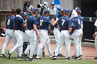 Wingate Bulldogs starting pitcher Hunter Dula (17) is greeted by his teammates as he comes off the field between innings during the game against the Central Missouri Mules during the 2021 DII Baseball National Championship at Coleman Field at the USA Baseball National Training Complex on June 12, 2021 in Cary, North Carolina. The Bulldogs defeated the Mules 5-3. (Brian Westerholt/Four Seam Images)